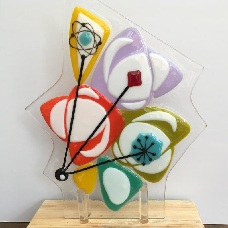 Fused glass panel on wooden stand