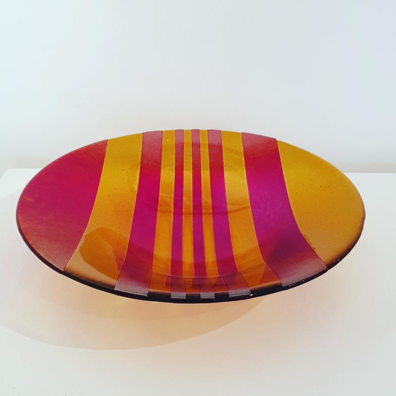 Large dish in red and amber glass