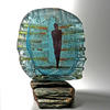 In the Shadows, sand cast glass, copper, slate. 23 x 18 cm