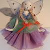 whimsical jointed porcelain fairy doll.