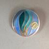 Champleve enamelled pendant with 24 caret gold foil
