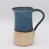 Simple stoneware jug in flecked clay