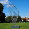 Wing by Diane Maclean  Stainless steel. Exhibited Salisbury Cathedral 2019 in solo exhibition Thresholds.  The base provides a seat.