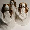 Christmas angels made from porcelain clay.