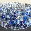 Knitted wire bracelet with blue beads