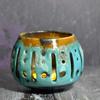 carved candle/tealight holder