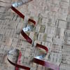 International Business: Woven stores extract mixed media newspaper and acrylic