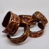 Copper cuff bangles lined with leather.