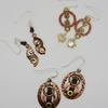 Copper and brass earrings made from washers., with sterling silver ear wires.