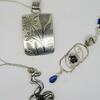 Sterling silver pendants.