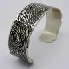 Sterling silver bangle with etched Celtic design.