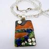 Mixed metal pendant with lapis lazuli and peridot chips on a rock crystal and opalite necklace.