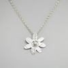 Daisy pendant with floral texture, Sterling silver