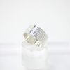 Band ring with textile texture