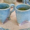 Two little blue mugs.