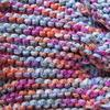 Detail of frilly edged scarf called Harlequin