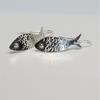 Golden eye fish earrings