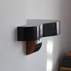 Chimney breast shelf made from a guitar.