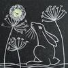 Lino cut showing a hare gazing at the Moon.
