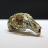 Encaustic wax, found rabbit skull, gold leaf by Hazel Godfrey