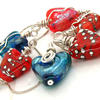 assortment of glass hearts with silver wire an chain.