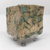 Balancing Box: stainless steel mesh pressed with oxidising St Thomas clay, raw glazed (matt turquoise stoneware) to stoneware - dimensions 70mm cube