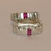 Ruby rings set in 18ct gold claws on cast silver rings
