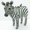 Ceramic stoneware zebra sculpture with zebra finch friends. 18cm high. £150