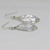 silver hammered drop earrings with raised silver midrib