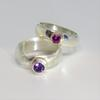Amethyst and garnet stones set in gold on silver rings