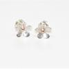 Silver forget-me-not, stud earrings with solid rose gold center.