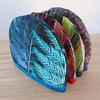 blue fern, phormium and peacock tea cosies, digitally printed and hand made, machine washable