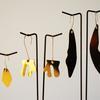 Silver gold & brass lips earrings by Teague