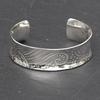Sterling silver mandala patterned anticlastic cuff bangle