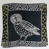 Lino cut of an owl in a dark prussion blue, with decorative border with stars.