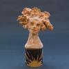 Figurehead: girl Ceramic, wax, copper, brass (H) 15cm, £400