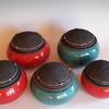 Group of raku pots with textured lids