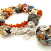 lampwork glass beads with silver fittings and baltic amber