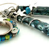 collection of bird houses with silver enamel and lampwork beads
