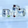 Wrap rings with Garnet and peridot stones set in silver ings