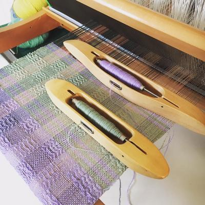 Silk weaving on a table top loom