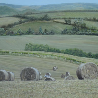 I love the calm feeling of late summer and views of haystacks scattered across fields.  This view from a walk towards Golden Cap in Dorset brings back lovely memories  of family holidays