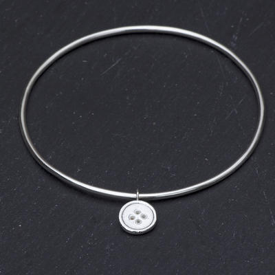 Sterling silver bangle with button charm