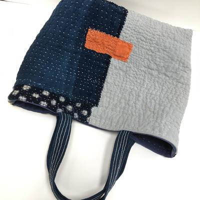 Handstitched boro bag, found cotton fabric scraps, pieced together using running stitch