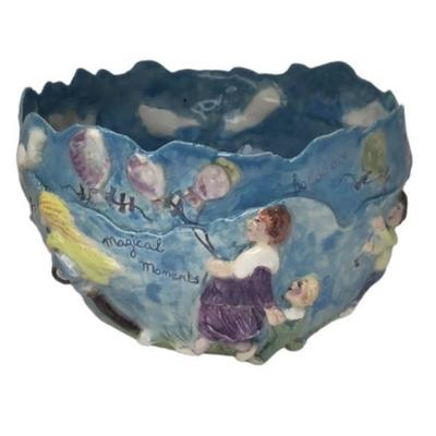 """Days to remember"" Blue double skin bowl with script and many figures surrounding the outside ;inside white fluffy clouds roll by .size : 20 x 20 x 11cm"