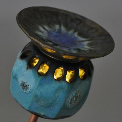 carved ceramic poppy seed head lantern