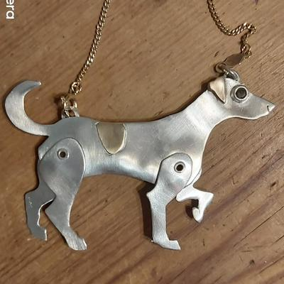 silver and gold necklace, a Jack Russel with moving legs a gold back patch and ear with a lovely deep smokey quartz eye. all hanging off a solid 9 ct fine gold chain.