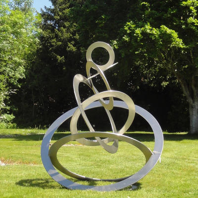 Sky Circles by Diane Maclean Stainless steel: all circles cut from a single sheet. Exhibited Salisbury cathedral 2019.  Collection of Queenswood School 2020