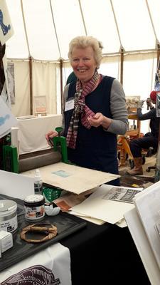 Demonstrating lino printing.