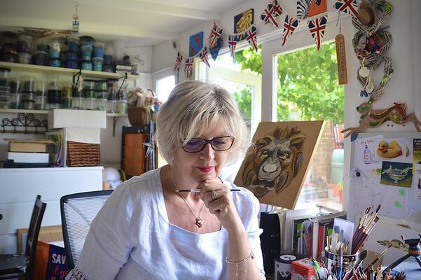 Beverley Sweetman at work in her art studio